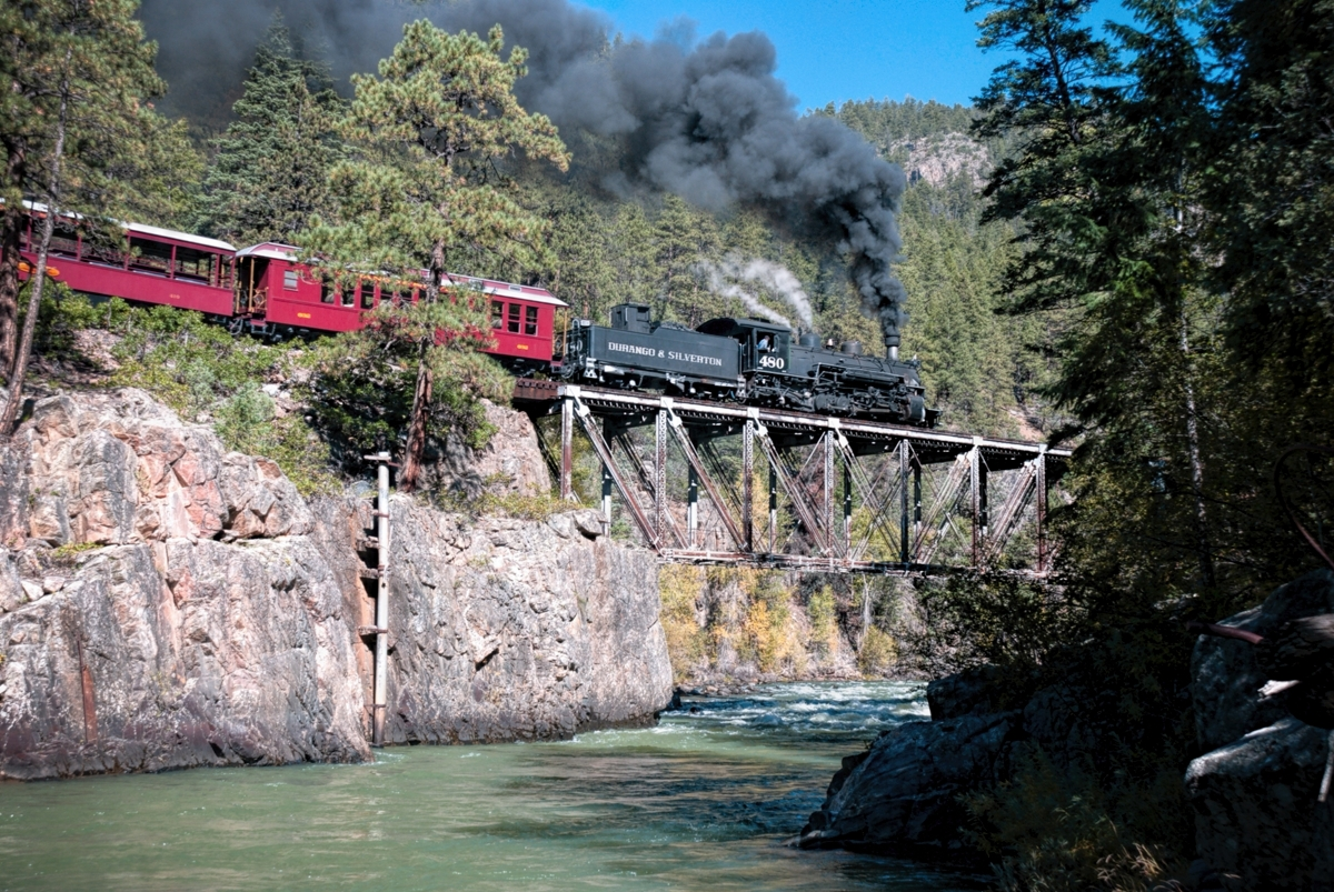 Silverton Colorado bound morning passenger train crosses the high bridge over the Animas River on the Durango Silverton NG Railroad...