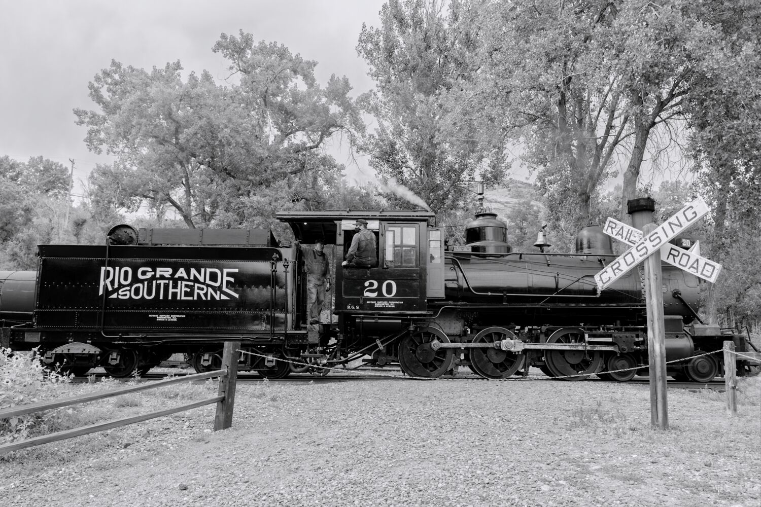 Rio Grande Southern number 20 sits at a railroad crossing waiting for the highball so she can continue on with her chores at...