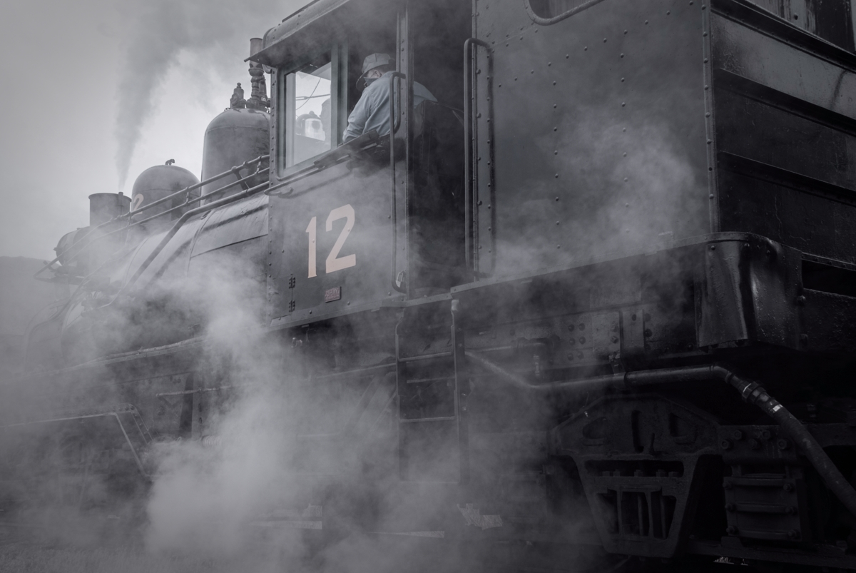 This railroader has full control of shay locomotive number 12 at the Colorado Railroad Museum in Golden Colorado. Taken during...