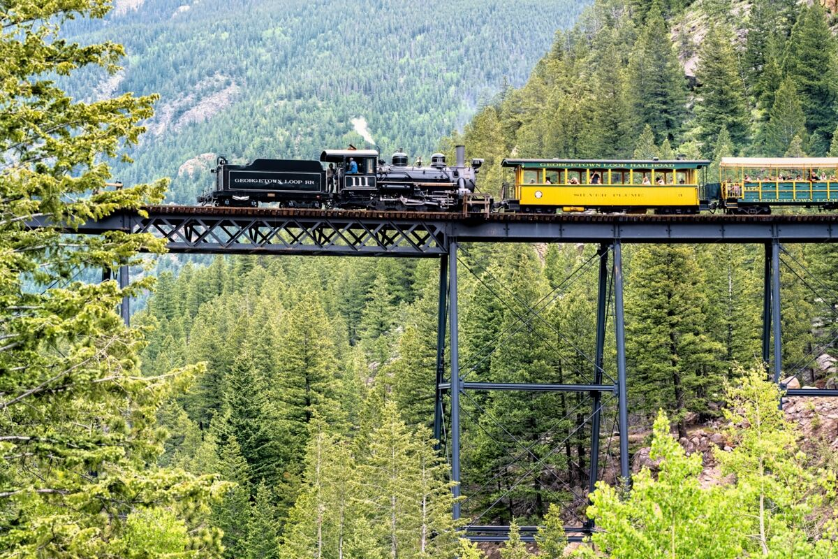 Crossing Devils Gate Bridge and heading to Devils Gate Station coming in from Silver Plume on the Georgetown Loop Railroad outside...