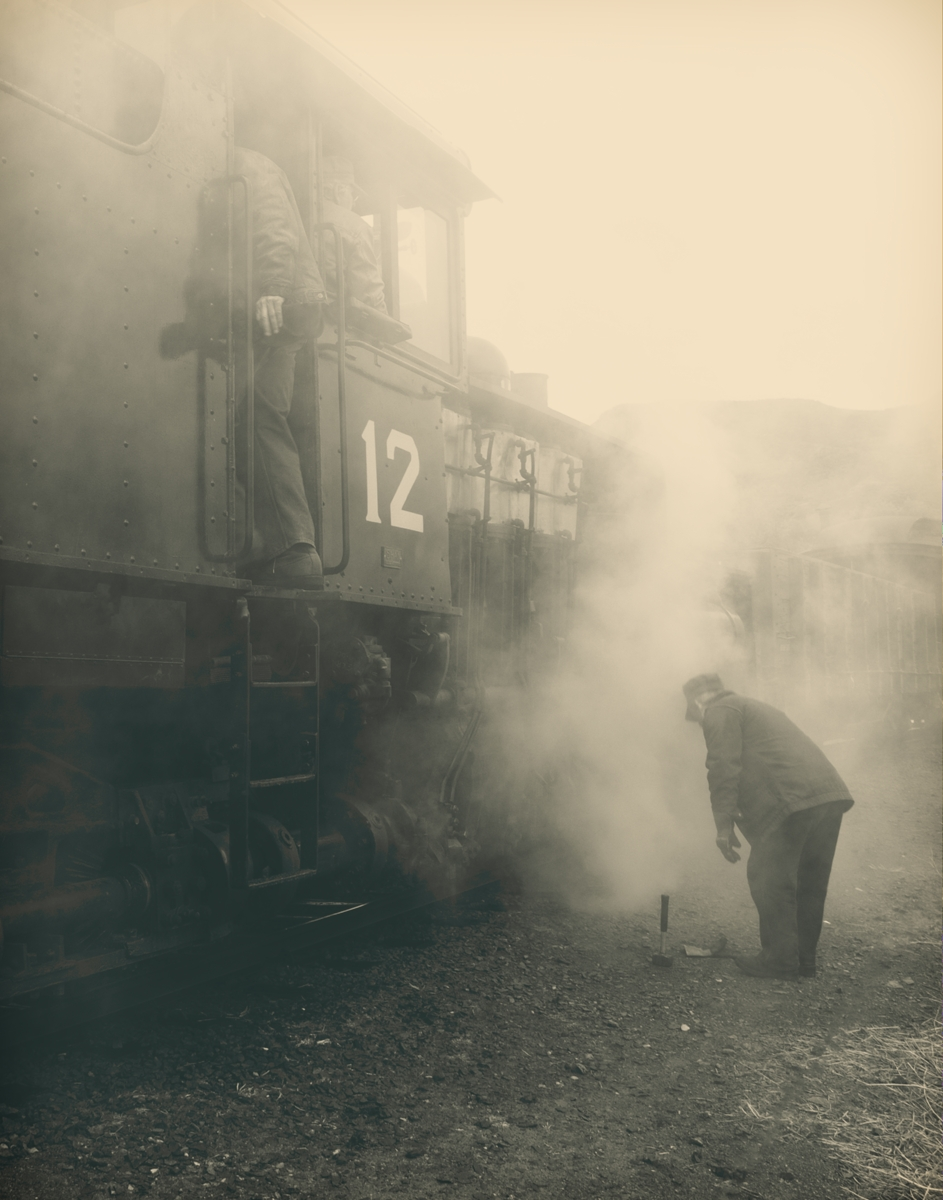 Lots of mood in this photograph of Shay number 12 getting a quick repair from a crew member at the Colorado Railroad Museum in...